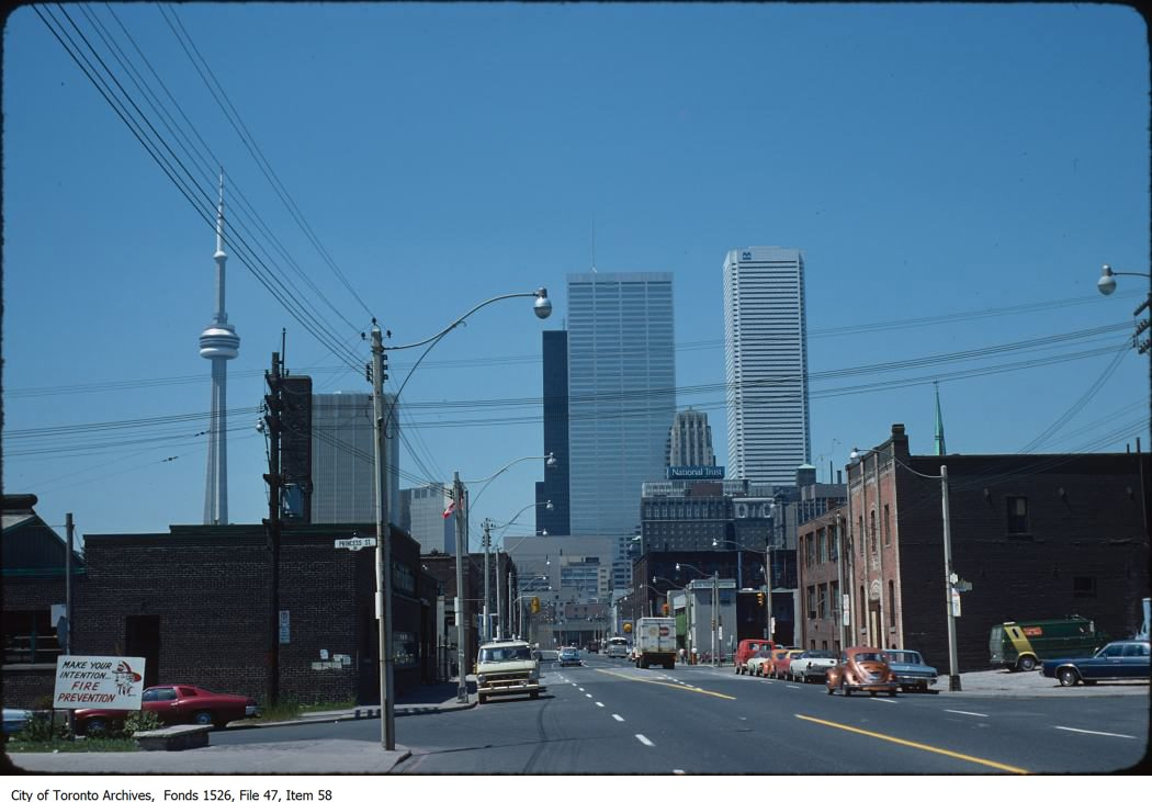 File consists of 99 35mm Kodachrome slide transparencies of the CN Tower, including construction shots of the Sikorsky S-64E Sky-Crane helicopter, Olga, hoisting the final pieces of the tower's antenna in 1975.
