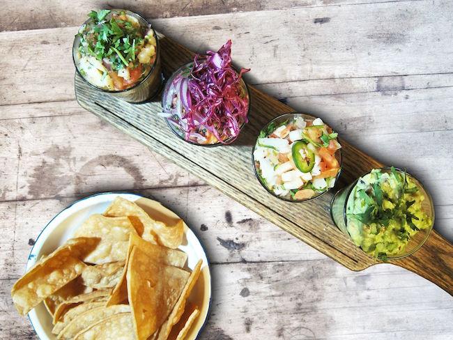 The Amigos Flight: white wild bass ceviche, octopus ceviche, delicious guacamole and pico de gallo at La Mezcaleria (La Mezcaleria/Facebook
