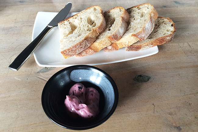 Fresh rustic bread with a house-made blueberry sage butter (Jess Fleming / Daily Hive)