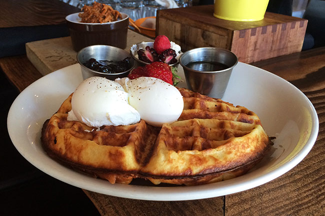 Belgian-style waffle with poached eggs (Jess Fleming / Daily Hive)