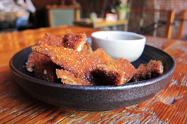 Crispy pork schnitzel (Jess Fleming / Daily Hive)