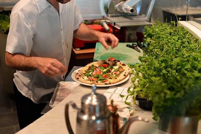 Pizza making at Nicili Antica Pizzeria (Jess Fleming / Daily Hive)