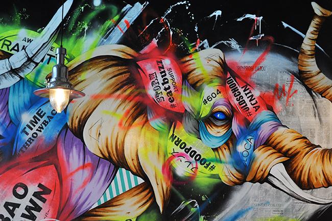 Vibrant-coloured wall mural at Bao Down (Jess Fleming / Daily Hive)