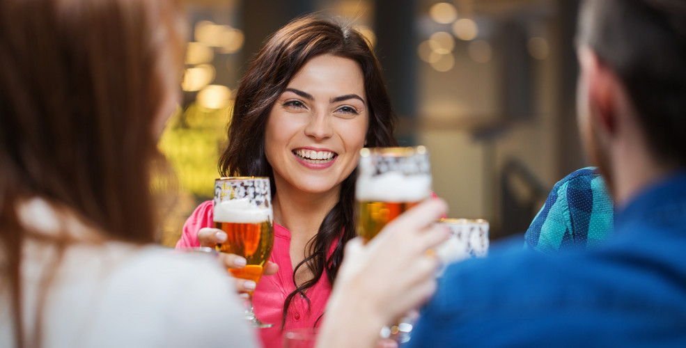 Cheers with beer smiling woman