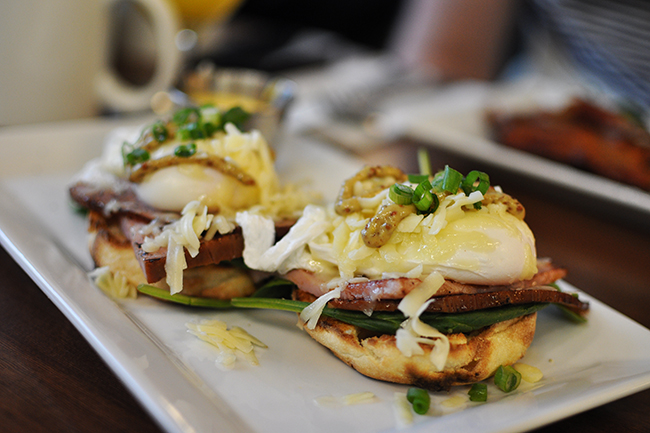 Eggs Benedict topped with cheese (Jess Fleming/Daily Hive)