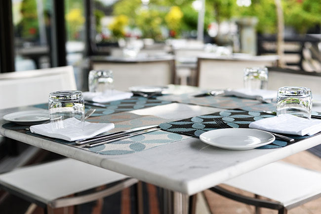 Patio seating at Ancora (Jess Fleming / Daily Hive)