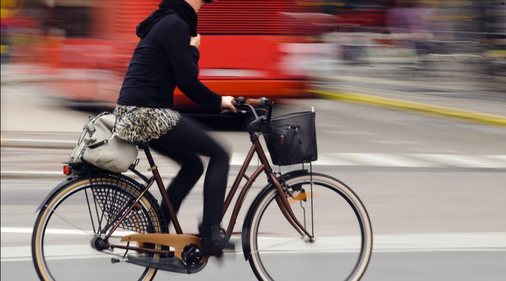 Woman biking (Rikard Stadler/Shutterstock)