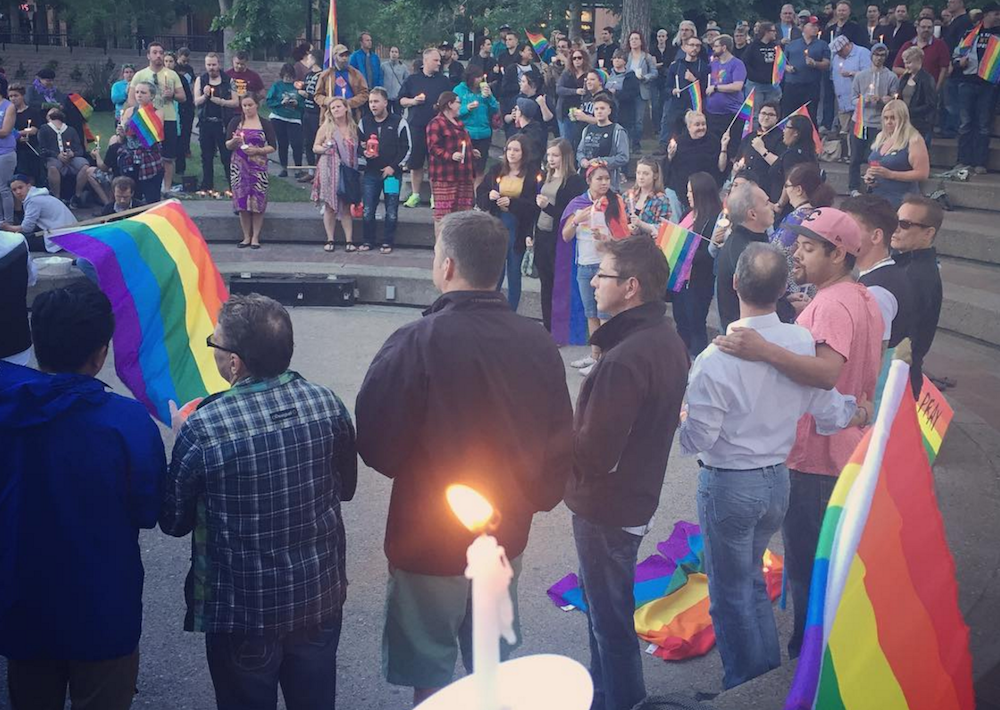 Calgarians gather to mourn Orlando shooting victims at Olympic Plaza (PHOTOS)