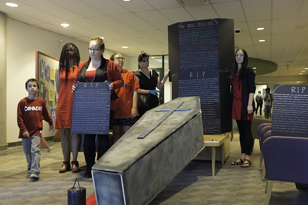 Protesters delivered the coffin and gravestones to the Vancouver School Board on Monday night (Jenni Sheppard)