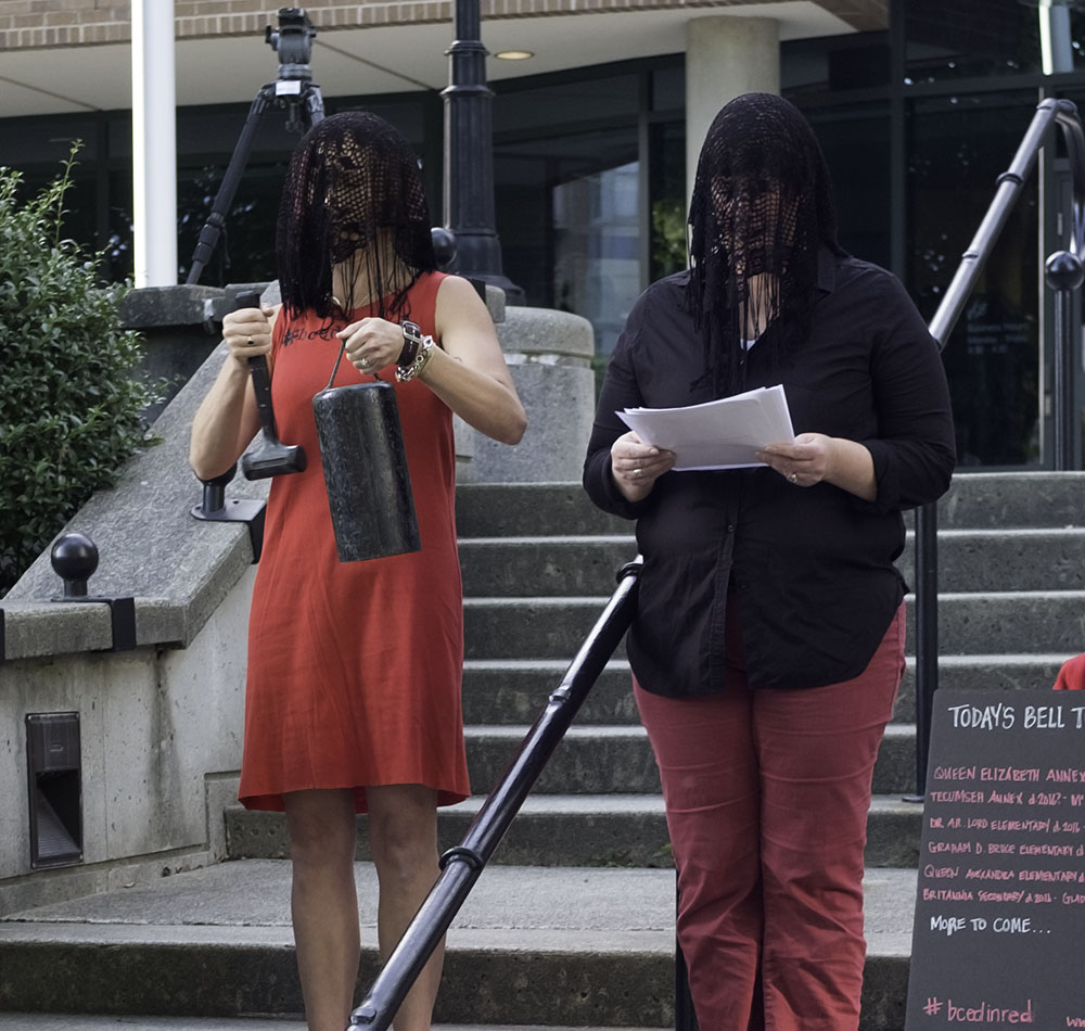 PAN co-founder Andrea Sinclair (right) read aloud the names of BC schools that have closed or are slated to close (Jenni Sheppard)