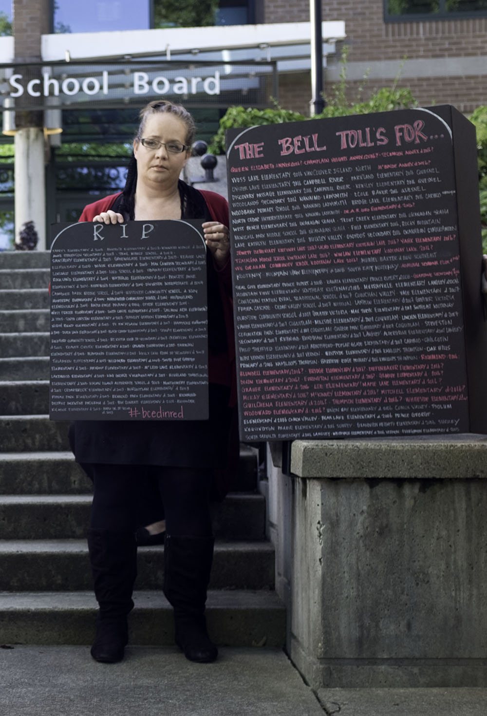 Protesters had made up gravestones listing all the names of the schools read aloud (Jenni Sheppard)