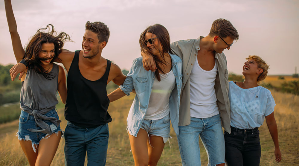 Group of people celebrating the summer stocksy