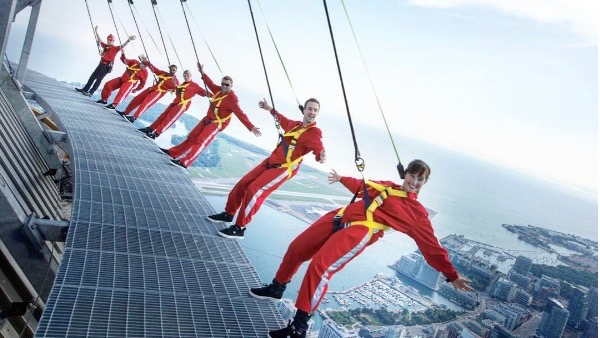 10 of the best (and funniest) CN Tower EdgeWalk pics ever taken