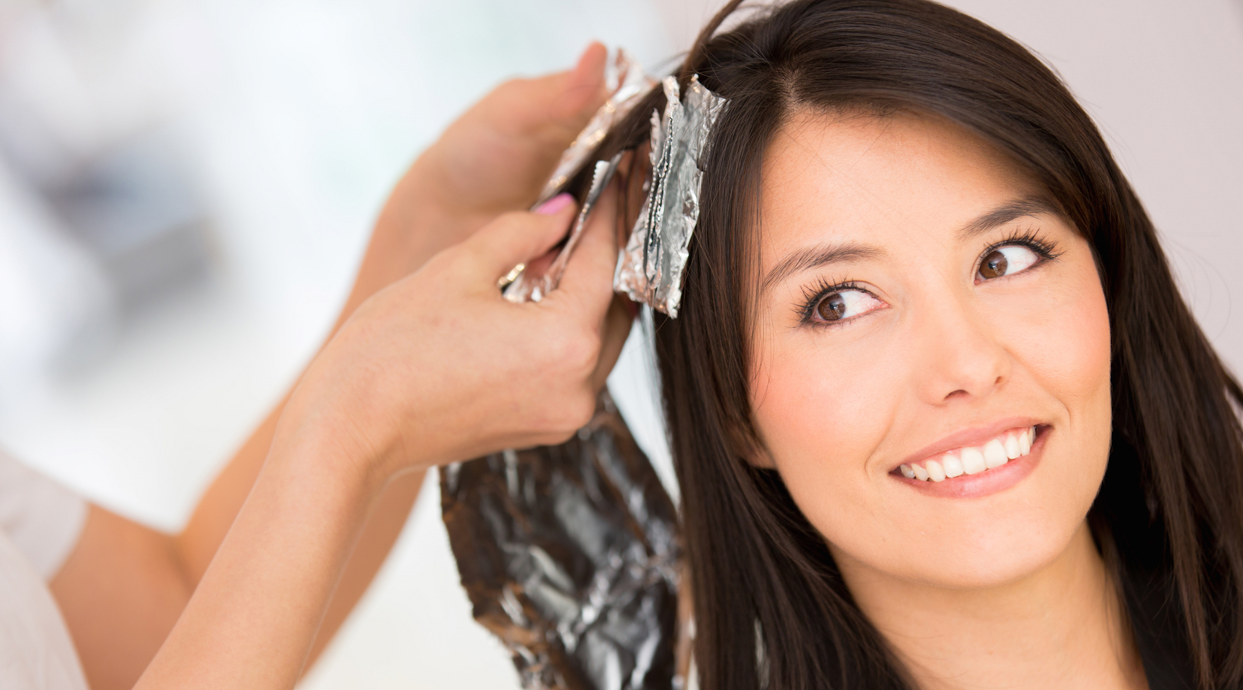 Woman dying hair beauty salon