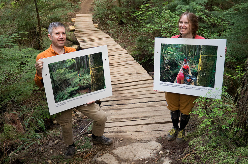 Trail builders Martin Newman and Penny Deck stand proudly with two of the photos (Euan Forrester)