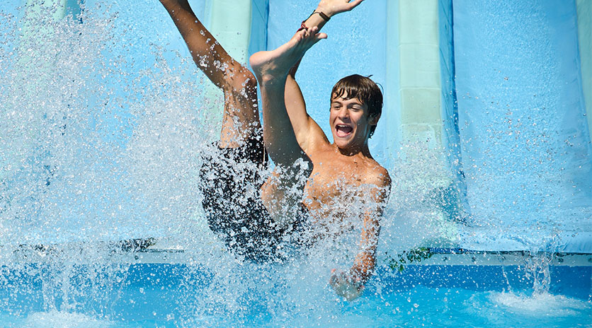 A happy swimmer at wild rapids water park at sylvan lake