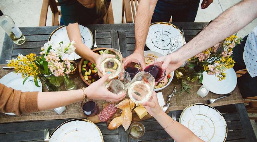 Group wine glasses table stocksy
