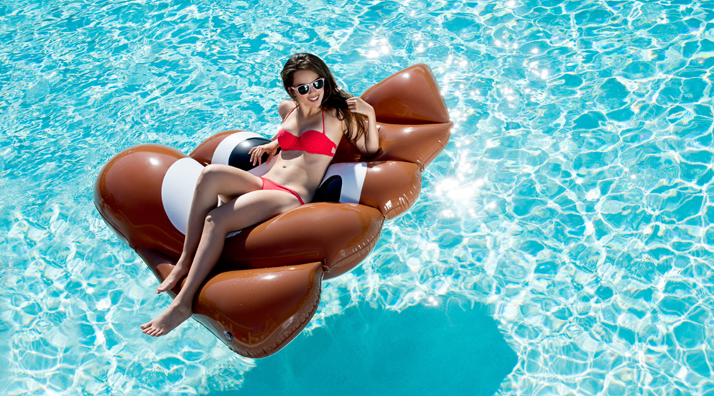 You need to float on this poop emoji this summer