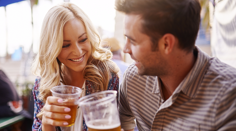 Woman and man drinking on the patio (Joshua Resnick/Shutterstock)