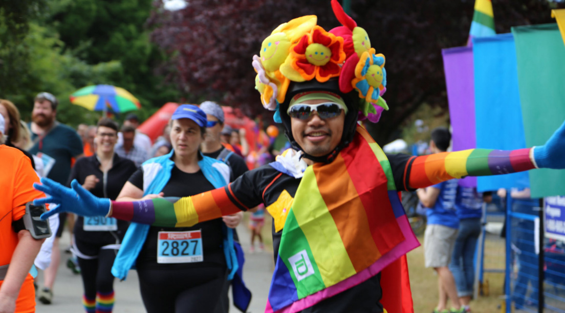 A happy participant at Pride Run and Walk (Vancouver Frontrunners)