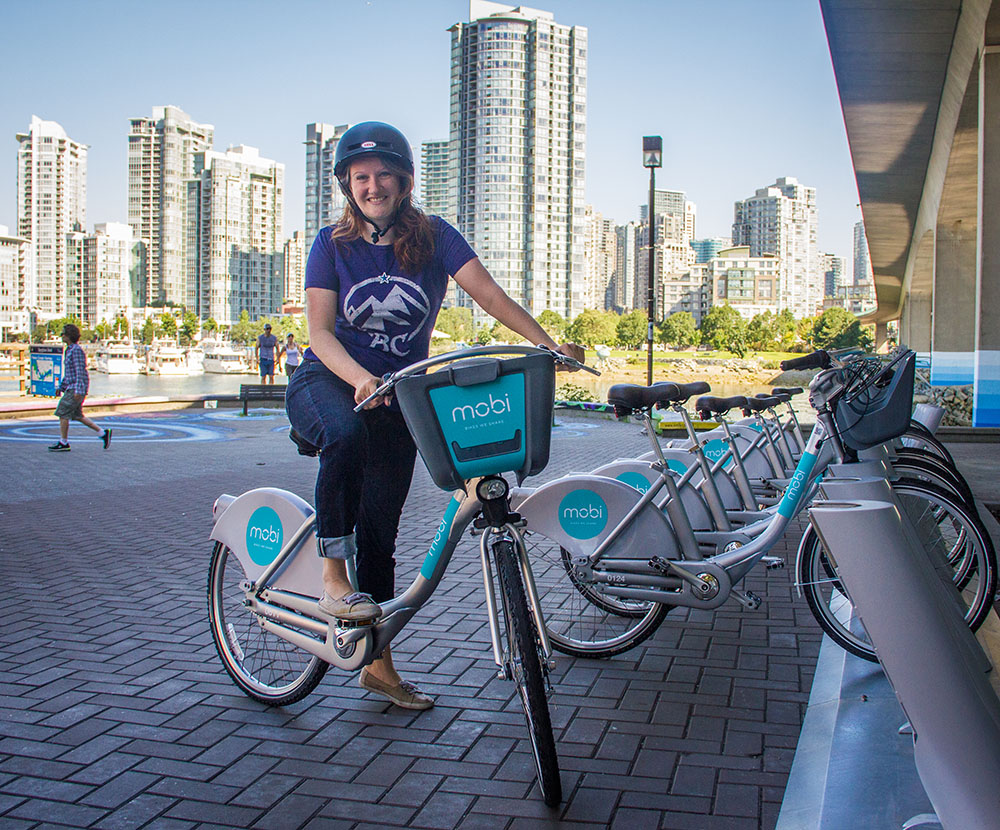 Daily Hive reporter Jenni Sheppard on one of the new Mobi bikes (Daily Hive)