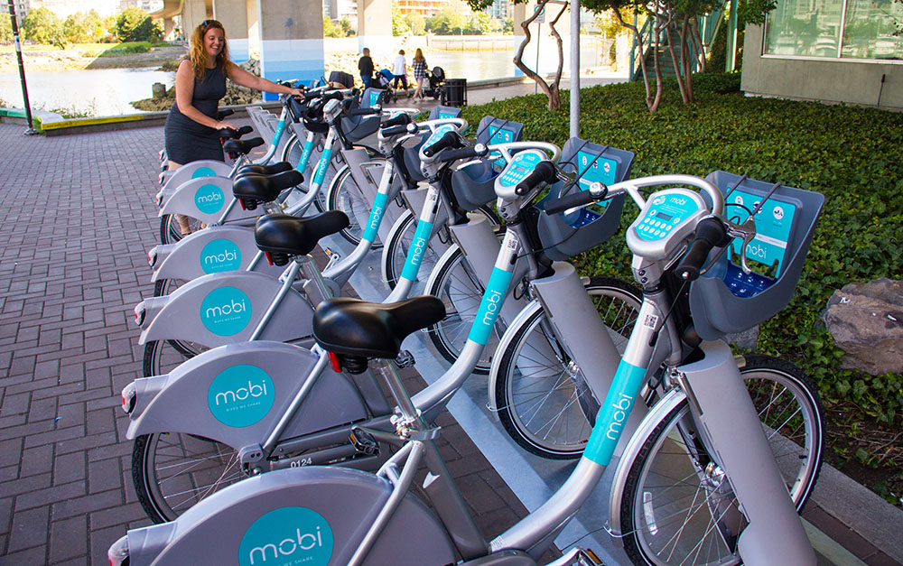 Mobi general manager and keen cyclist Mia Kohout with the new Mobi bikes (Jenni Sheppard/Daily Hive)