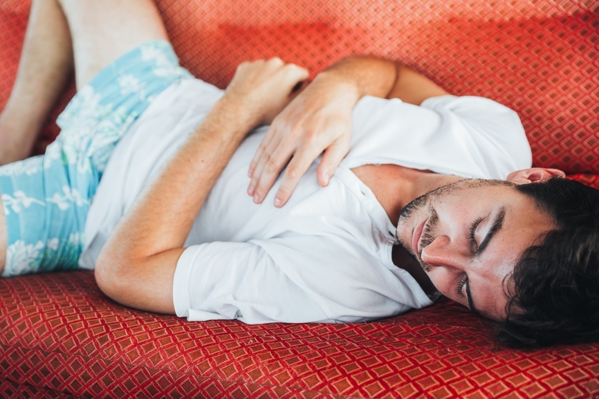 Man asleep on a couch alejandro moreno de carlosstocksy