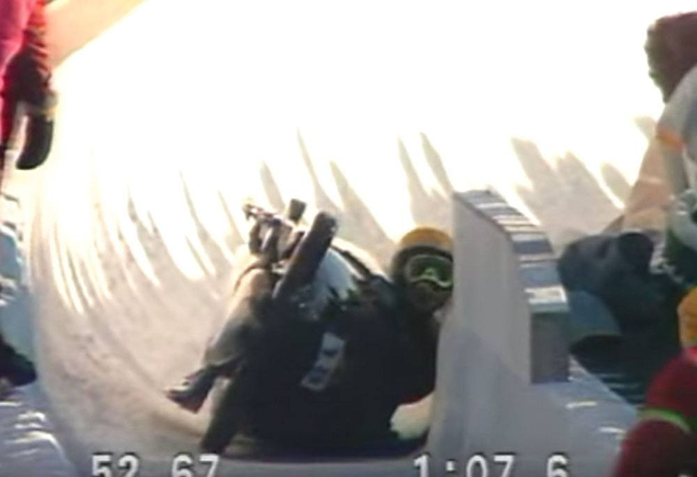 A screenshot showing the crash - and Dudley Stokes' helmet scraping along the bobsleigh run - during the 1988 Calgary Winter Olympics (RR Auction)