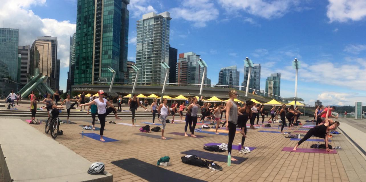 Free summer yoga at Jack Poole Plaza is in full swing
