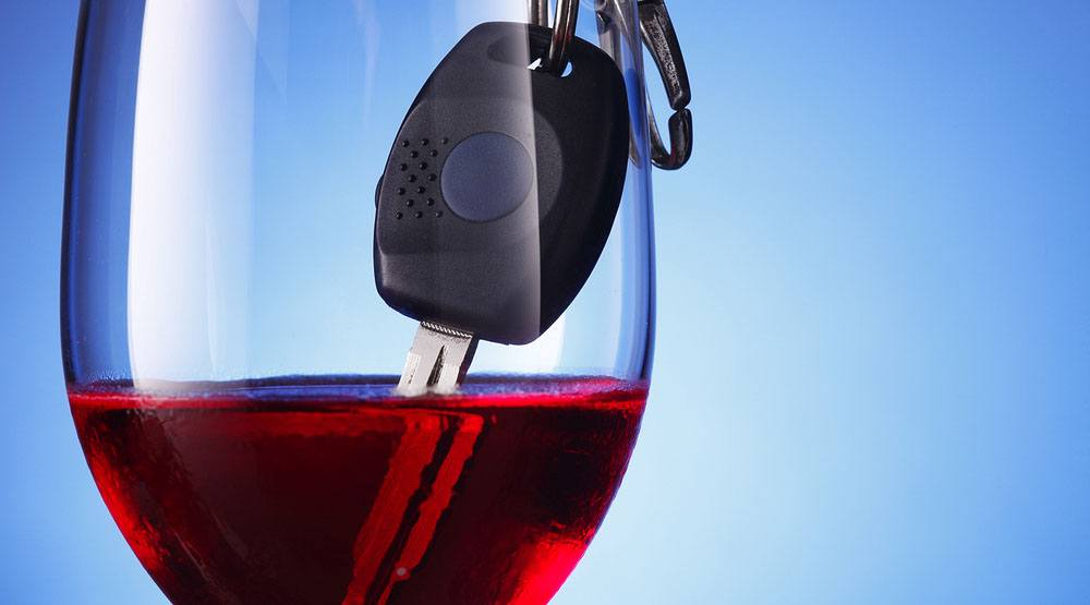 Drunk driving glass of wine car keys focal pointshutterstock