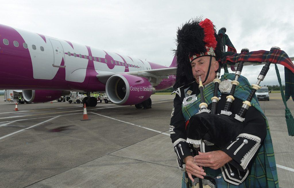 Picture by Lesley Martin 17 July 2016. Launch of Wow air at Edinburgh Airport. Flight attendants are Margret, Helga, Kolburn and Captain Damien. Piper, Pipe Major Bill Loughridge. © Lesley Martin 2016 - All Rights Reserved t: 07836745264 e: lesley@lesleymartin.co.uk