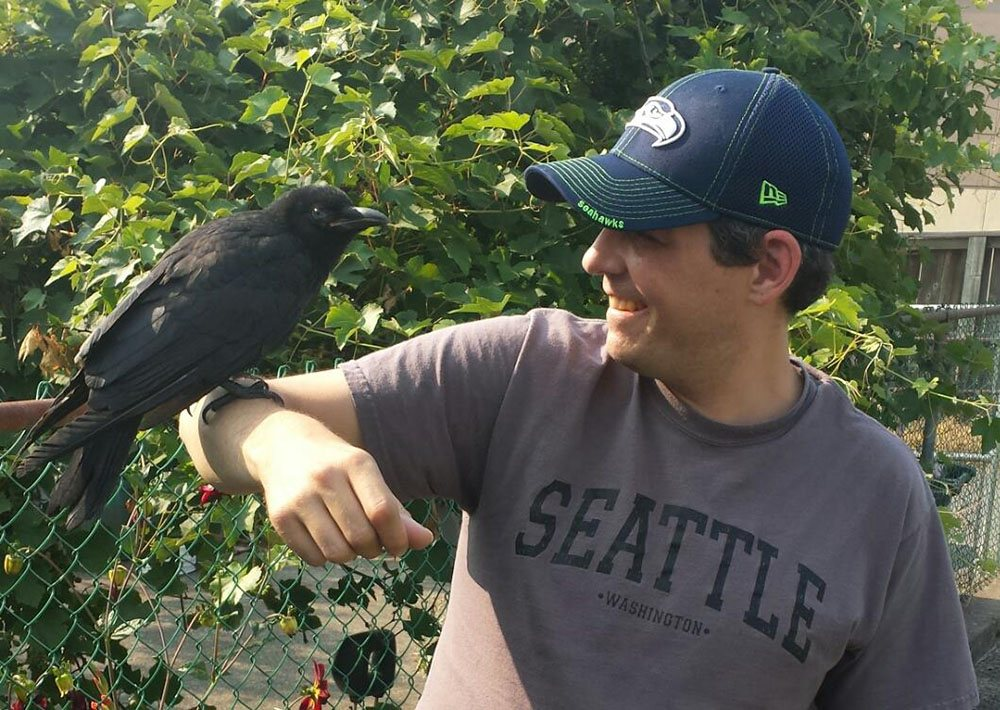Shawn Bergman shortly after meeting Canuck the crow one year ago (Canuck and I/Facebook)
