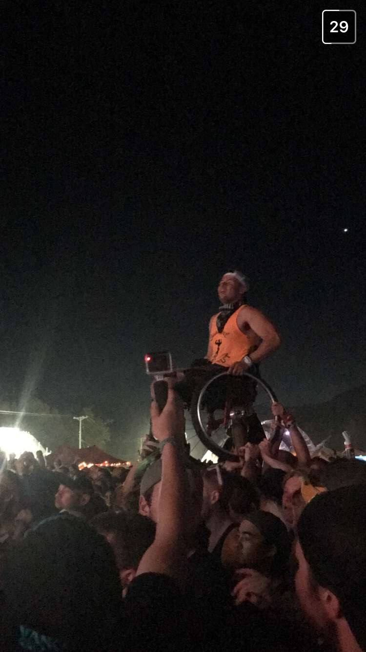 Crowd lifting person at Pemberton Music Festival