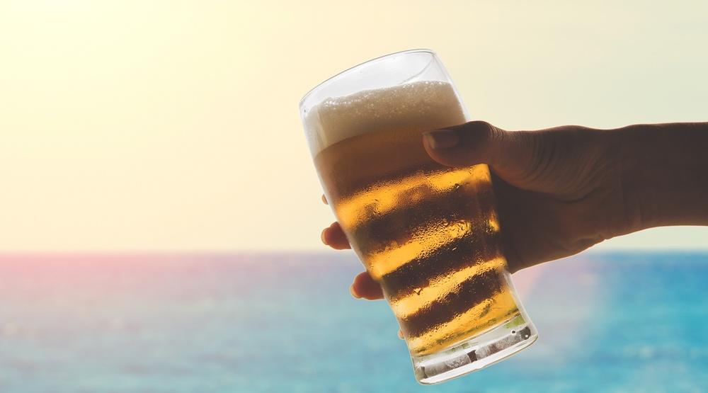 Beer hand sunshine water