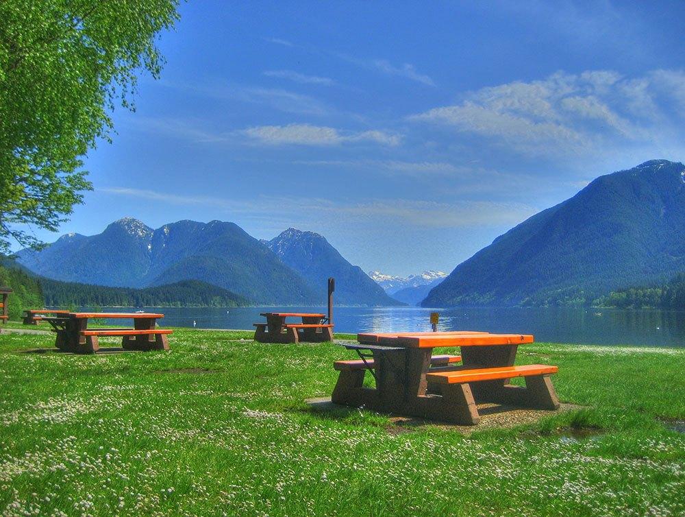 Picnic tables beside Alouette Lake in Golden Ears Provincial Park (Kyle Pearce/Flickr)