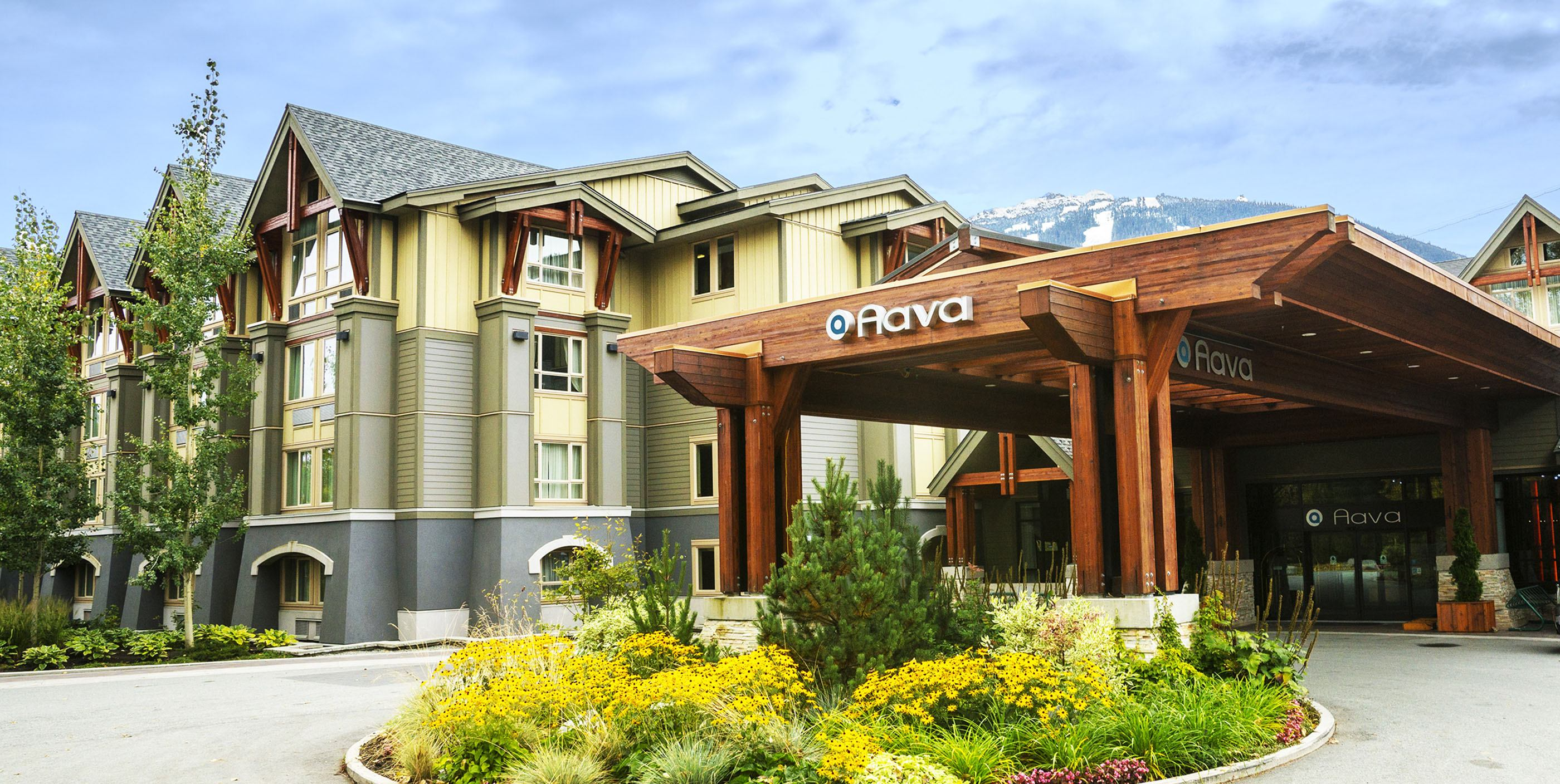 The Aava Whistler Hotel entrance with Blackcomb Mountain in the background (Aava Whistler Hotel)