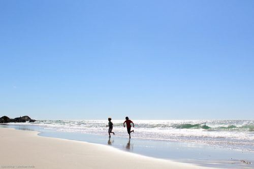 Running in the waves of Currumbin Beach