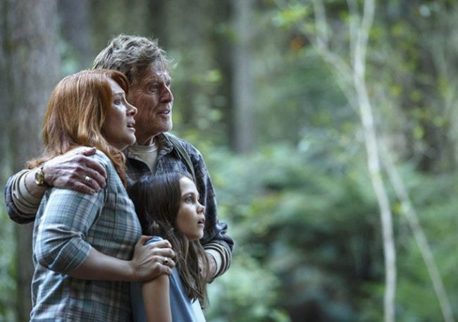 Meecham (Redford) Grace (Howard) and Natalie (Laurence) find Elliot in the forest. Image: Disney
