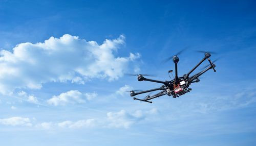 Image: iStock/Copter flight against the blue sky. RC aerial drone.