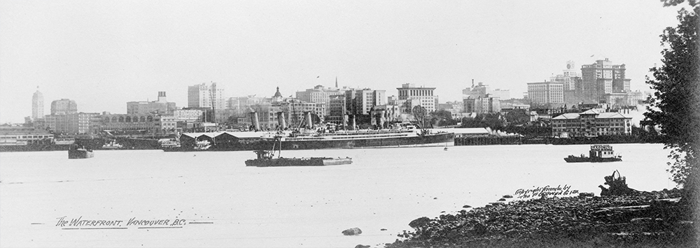 1929: The busy Vancouver waterfront, with a couple of big steamers docked at the huge piers. (Vancouver Archives)
