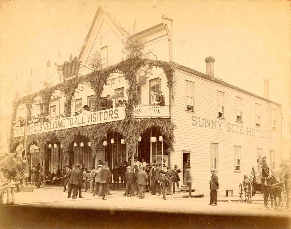 1887: The Sunnyside Hotel on Maple Tree Square, seen rebuilt just after the fire. (Vancouver Archive)