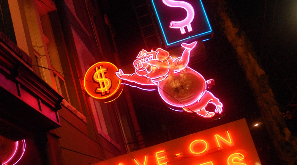 The famous Save On Meats neon sign in Gastown (Sergei Bachlakov/Shutterstock)