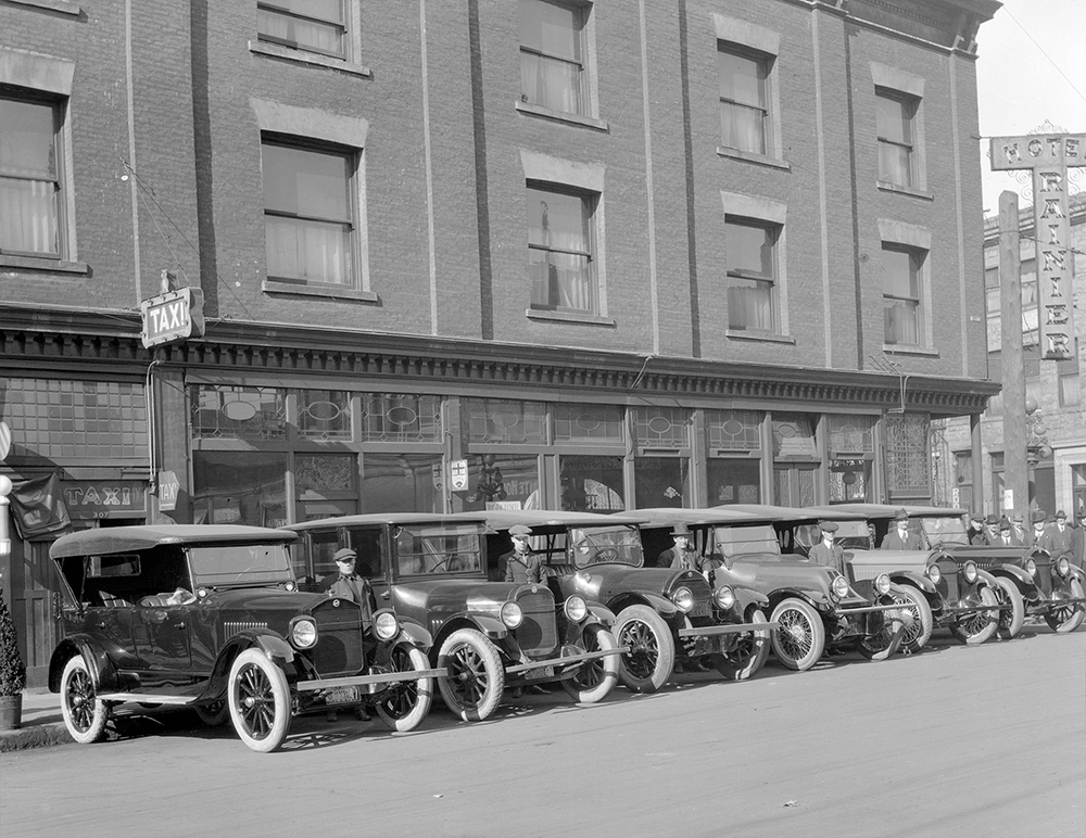 1920: Drivers proudly pose with their taxis. (Vancouver Archives)
