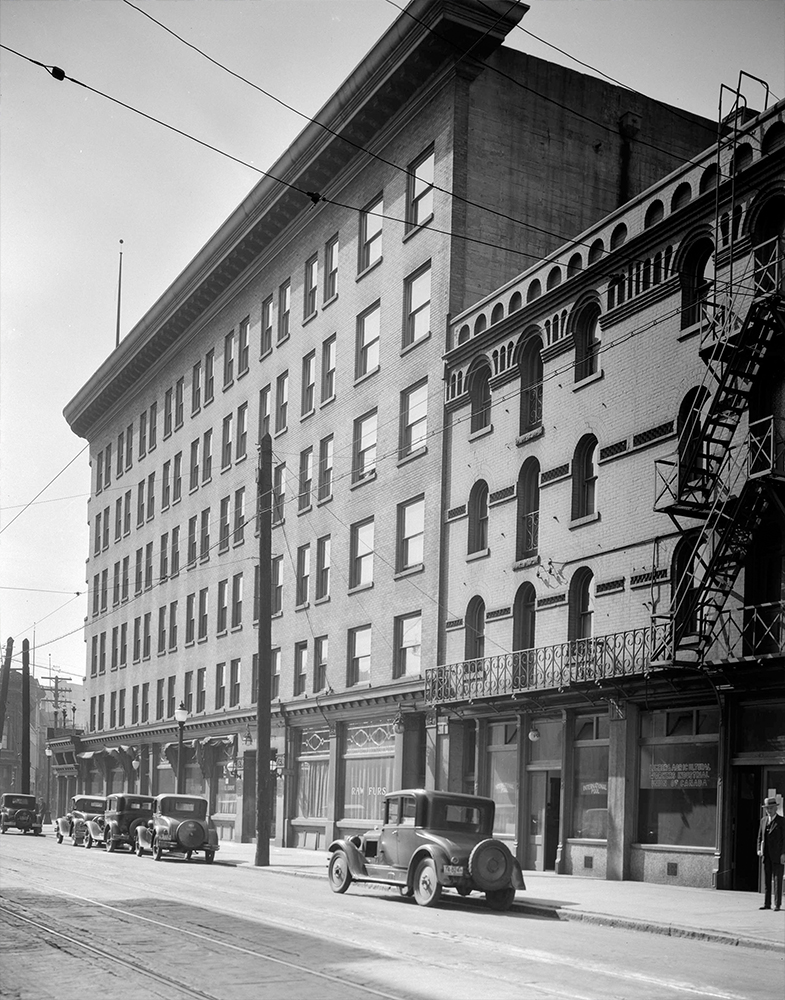 1931: Cars parked in front of the Hotel Europe. (Vancouver Archives)
