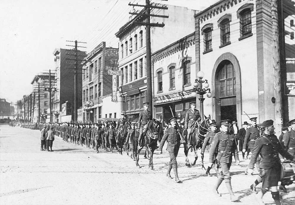 1915: Troops from the 29th Vancouver Battalion march east down Pender. (Vancouver Archives)