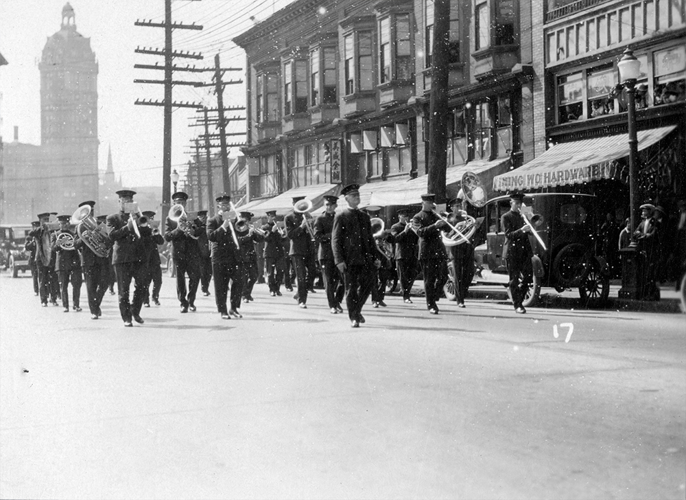 1927: A marching band takes part in the funeral parade of prominent Chinese-Canadian businessman Yip Sang. (Vancouver Archives)