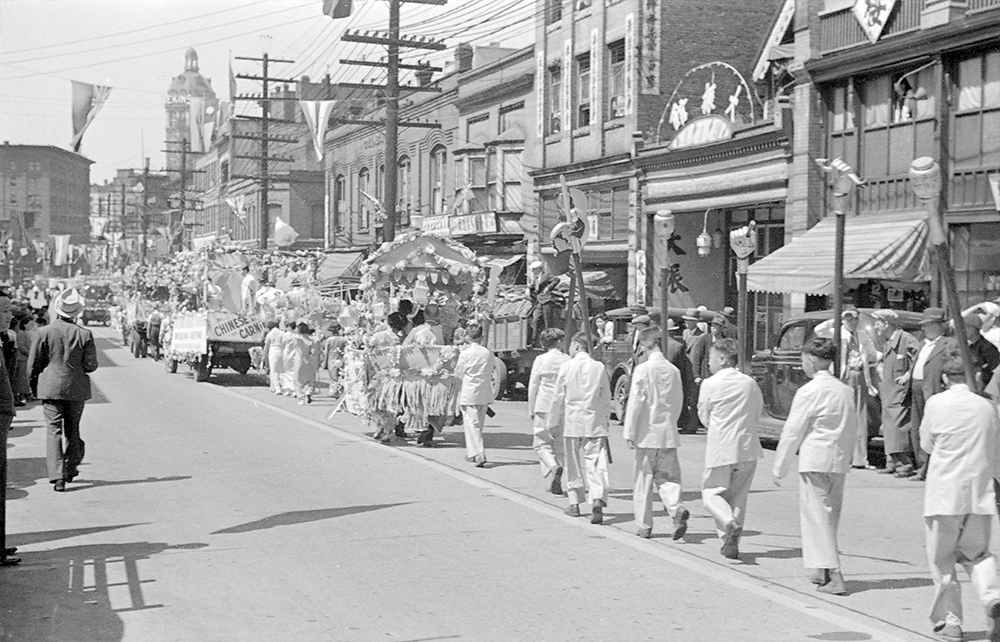 1936: A parade for the Chinese Carnival going down Pender Street. (Vancouver Archives)