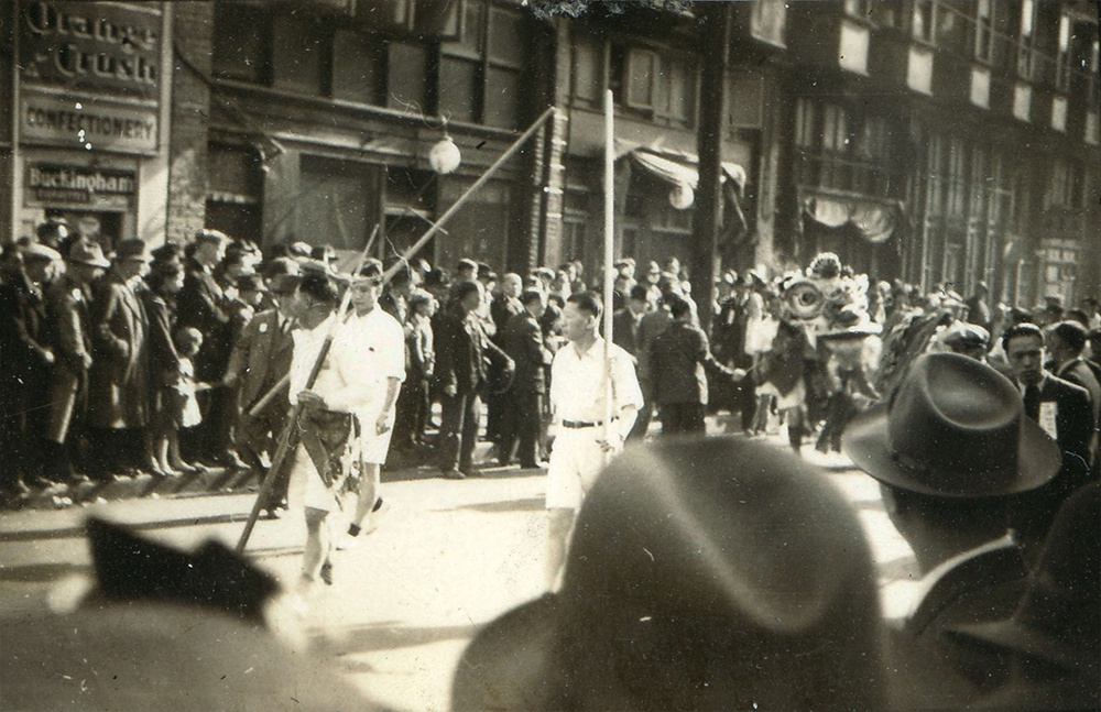 1937: A crowd has gathered for a funeral procession down Shanghai Alley. (Vancouver Archives)