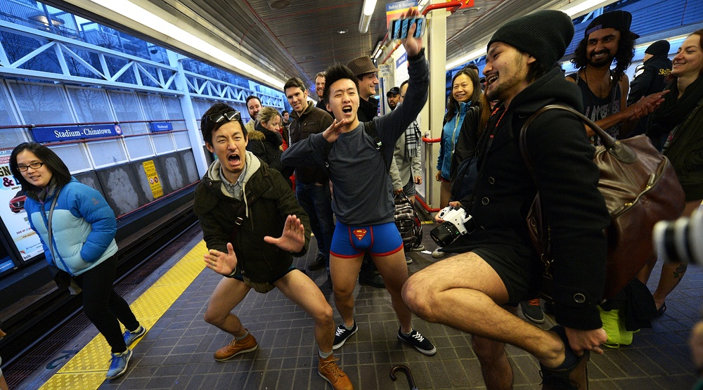 Vancouvers skytrain was busy with bare legs as hundreds of people took off their pants during the 2014 no pants subway ride sergei bachlakovshutterstock