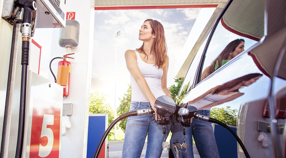 Woman filling up at gas station gergely zsolnaishutterstock